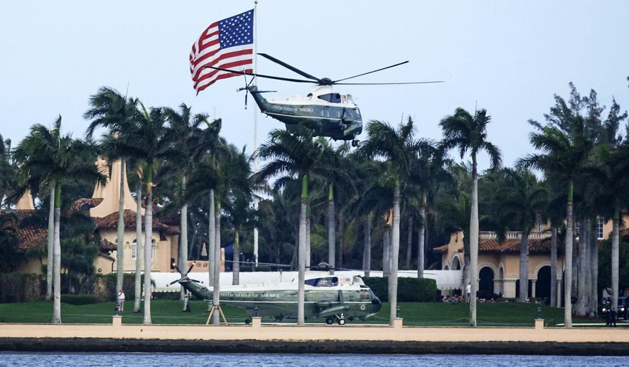 Two Marine Corps helicopters depart from President Donald Trump's Mar-a-Lago resort in Palm Beach, Fla., Monday afternoon, Feb. 18, 2019. Trump later spoke to a Venezuelan American community at Florida International University in Miami. (Bruce R. Bennett/Palm Beach Post via AP)