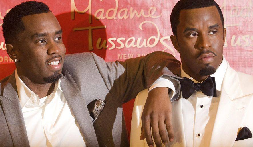 "FILE - In this Dec. 15, 2009 file photo, Sean ""Diddy"" Combs unveils his wax figure at Madame Tussauds in New York. Police say someone attacked the statue of Combs at the wax museum, Saturday, Feb. 16, 2019, shoving the rap impresario's likeness so forcefully it lost its head. (AP Photo/Charles Sykes, File)"