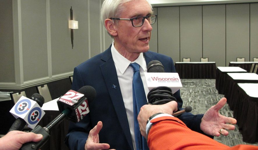FILE- In this Feb. 12, 2019, file photo Wisconsin Gov. Tony Evers voices opposition to a Republican-authored income tax cut bill, saying he favors his plan which would all-but eliminate a manufacturing tax credit in Madison, Wis. Evers said Monday, Feb. 18, that his budget will include proposals to decriminalize possession of small amounts of marijuana for personal use and legalize medical marijuana.(AP Photo/Scott Bauer, File)