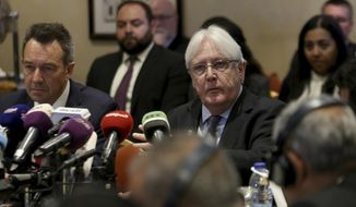 "FILE - In this Tuesday, Feb. 5, 2019 file photo, United Nations Special Envoy to Yemen Martin Griffiths, center, and President of the International Committee of the Red Cross Peter Maurer, participate in a new round of talks by Yemen's warring parties in Amman, Jordan. Yemeni security officials said sunday, Feb. 17, 2019, that Griffiths arrived in the Yemeni capital, Sanaa, to discuss the ""complex situation"" in and around the key port city of Hodeida. (AP Photo/Raad Adayleh, File)"