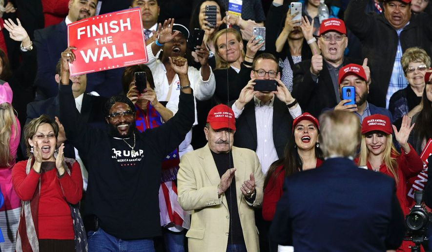 President Trump turns to greets his fans during a campaign rally in El Paso, Texas last week. Mr. Trump retains solid support among the GOP. (Associated Press)