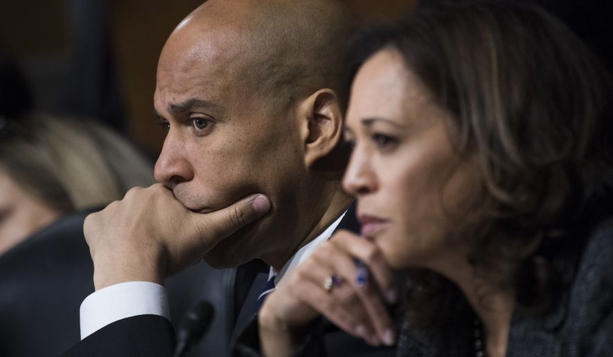 In this Sept. 27, 2018, file photo, Sen. Cory Booker, D-N.J., and Sen. Kamala Harris, D-Calif., listen as Dr. Christine Blasey Ford testifies during the Senate Judiciary Committee hearing on the nomination of Brett M. Kavanaugh to be an associate justice of the Supreme Court of the United States, focusing on allegations of sexual assault by Kavanaugh against Christine Blasey Ford in the early 1980s. (Tom Williams/Pool Photo via AP)