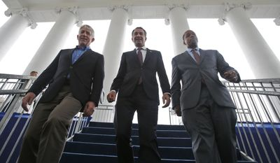 In this Jan. 12, 2018, file photo, Virginia Gov.-elect, Lt. Gov Ralph Northam, center, walks down the reviewing stand with Lt. Gov-elect, Justin Fairfax, right, and Attorney General Mark Herring at the Capitol in Richmond, Va.  The political crisis in Virginia exploded Wednesday, Feb. 6, 2019,  when the state's attorney general confessed to putting on blackface in the 1980s and a woman went public with detailed allegations of sexual assault against the lieutenant governor. With Northam's career already hanging by a thread over a racist photo, the day's developments threatened to take down all three of Virginia's top elected officials.  (AP Photo/Steve Helber, File)
