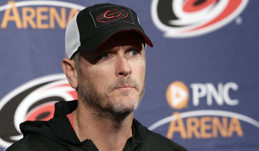 FILE - In this May 9, 2018, file photo, Carolina Hurricanes owner and CEO Tom Dundon takes questions during an NHL hockey news conference in Raleigh, N.C. Dundon is investing $250 million in the Alliance of American Football. Dundon also will serve as chairman of the fledgling eight-team league that began play on Feb. 9. His involvement came together in a matter of days last week, according to Dundon and Alliance co-founder Charlie Ebersol, though Dundon had been monitoring the AAF's development and debut. Ebersol dismissed reports Tuesday, Feb. 19, 2019, that the Alliance was getting a financial bailout from Dundon.(AP Photo/Gerry Broome) ** FILE **