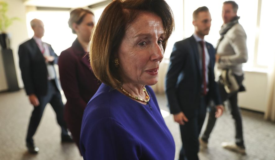 U.S. Speaker of the House Nancy Pelosi leaves after a press conference in Brussels, Tuesday, Feb. 19, 2019. (AP Photo/Francisco Seco)