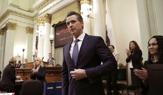 In this Feb. 12, 2019, file photo, Calif., Gov. Gavin Newsom receives applause after delivering his first State of the State address to a joint session of the legislature at the Capitol in Sacramento, Calif. Newsom declared in his first State of the State address last week that he planned to scale back California's high-speed rail project and focus immediately on building 171 miles of track in central California. The Trump administration said Tuesday, Feb. 19, that it plans to cancel $929 million awarded to California's high-speed rail project and wants the state to return an additional $2.5 billion that it has already spent. (AP Photo/Rich Pedroncelli, File)