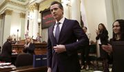 FILE - In this Feb. 12, 2019, file photo, Calif., Gov. Gavin Newsom receives applause after delivering his first State of the State address to a joint session of the legislature at the Capitol in Sacramento, Calif. Newsom declared in his first State of the State address last week that he planned to scale back California's high-speed rail project and focus immediately on building 171 miles of track in central California. The Trump administration said Tuesday, Feb. 19, that it plans to cancel $929 million awarded to California's high-speed rail project and wants the state to return an additional $2.5 billion that it has already spent. (AP Photo/Rich Pedroncelli, File)
