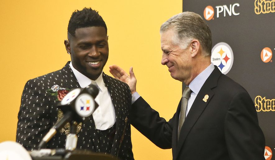 FILE - In this Feb. 28, 2017, file photo, Pittsburgh Steelers wide receiver Antonio Brown, left, smiles as he is introduced by Steelers President Art Rooney II for a news conference about Brown's contract extension at the NFL football team's headquarters, Tuesday, Feb. 28, 2017, in Pittsburgh. Steelers wide receiver Antonio Brown has ended his lengthy standoff with the team by meeting with president Art Rooney II, though any shot at reconciliation between the two sides appears to be out of the question. Brown, who has asked to be traded, posted a picture on various social media accounts on Tuesday, Feb. 19, 2019,  that showed him arm in arm with Rooney at the Palm Beach International Airport. (AP Photo/Keith Srakocic, File) **FILE**
