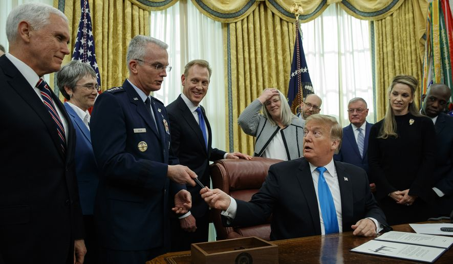 "President Donald Trump hands a pen to Air Force Gen. Paul Selva after signing ""Space Policy Directive 4"" in the Oval Office of the White House, Tuesday, Feb. 19, 2019, in Washington. (AP Photo/ Evan Vucci) **FILE**"