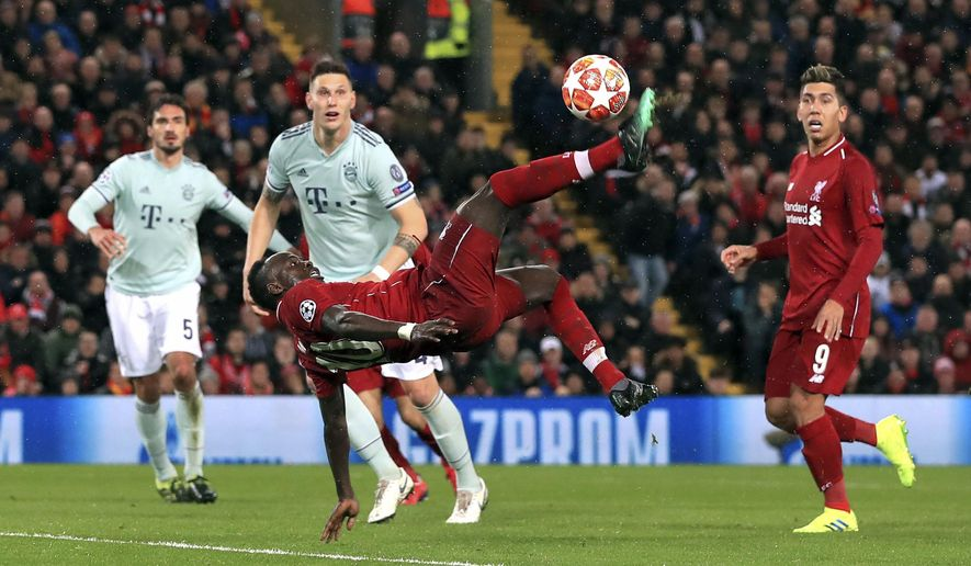 Liverpool's Sadio Mane attempts an overhead kick, during the Champions League round of 16 first leg soccer match between Liverpool and Bayern Munich,  at Anfield, in Liverpool, England, Tuesday, Feb. 19, 2019. (Peter Byrne/PA via AP)