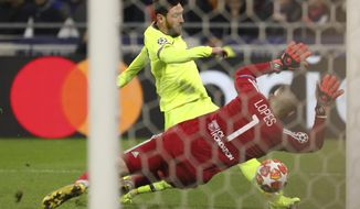 Barcelona forward Lionel Messi, left, fails to score past Lyon goalkeeper Anthony Lopes, right, during the Champions League round of 16 first leg soccer match between Lyon and FC Barcelona in Decines, near Lyon, central France, Tuesday, Feb. 19, 2019. (AP Photo/Laurent Cipriani)