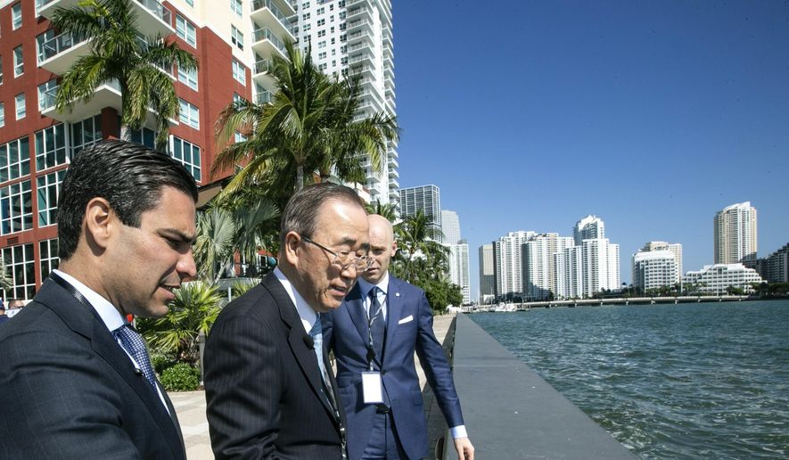 Miami Mayor Francis X. Suarez, left, gives former Secretary-General of the United Nations Ban Ki-moon, center, and Patrick V. Verkooijen, Chief Executive Officer of the Global Center on Adaptation, a tour of Miami's sea rise adaptation measures on Tuesday, Feb. 19, 2019. (Al Diaz/Miami Herald via AP) ** FILE **