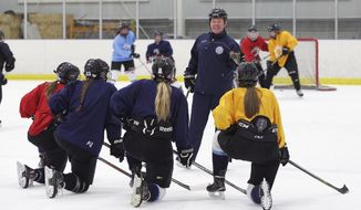 In this Feb. 11, 2019, photo provided by Bill Kerig, Great Coach Founder and CEO Bill Kerig works as a volunteer hockey coach for the Salt Lake City Lady Lightning U19 hockey team, in Salt Lake City. An advocacy group has published a first-of-its-kind comprehensive list of coaches banned from Olympic sports, creating a database of nearly 1,000 people no longer allowed to work in the U.S. Olympic system because of sex-abuse allegations, doping positives and other criminal activities involving minors. The website, designed by former pro moguls skier Bill Kerig, was originally started to help families find certified coaches who are best qualified to work with their kids. (Blake Palmer/William Kerig via AP)