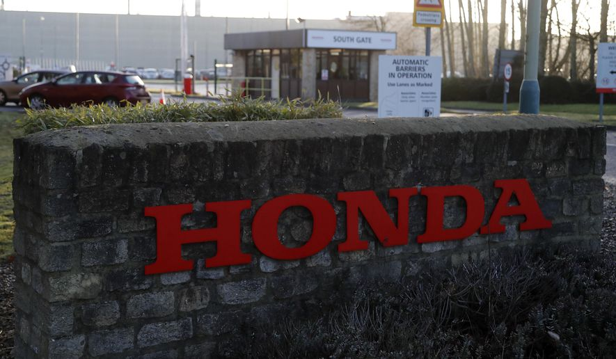 The South Gate entrance of the Honda car plant in Swindon, England, Tuesday, Feb. 19, 2019.  The Japanese carmaker announced Tuesday that the Swindon car plant in western England, where Honda makes its Civic model, will close in 2022, with the potential loss of some 3,500 jobs. (AP Photo/Frank Augstein)