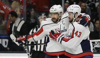 Washington Capitals' Alex Ovechkin, center, celebrates his goal with teammate Tom Wilson (43) during the first period of an NHL hockey game Monday, Feb. 18, 2019, in Los Angeles. (AP Photo/Marcio Jose Sanchez)