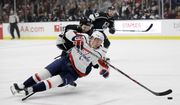 Washington Capitals' Jakub Vrana, bottom, falls as he reaches for the puck in front of Los Angeles Kings' Derek Forbort during the first period of an NHL hockey game Monday, Feb. 18, 2019, in Los Angeles. (AP Photo/Marcio Jose Sanchez) ** FILE **