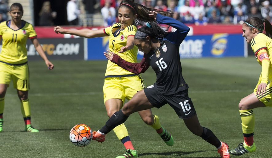 FILE- In this April 10, 2016, file photo, Colombia's Isabella Echeverri (5) battles for the ball against United States' Crystal Dunn (16) during the first half of an international friendly soccer match in Chester, Pa. Colombian women's national team players Isabella Echeverri and Melissa Ortiz are speaking out on social media about what they say are substandard conditions and discriminatory treatment by the federation. (AP Photo/Chris Szagola, File)