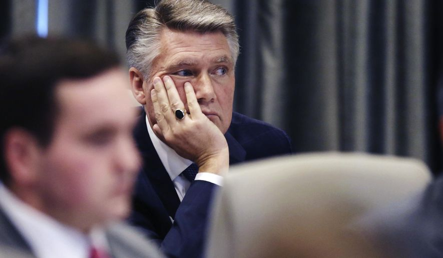 Mark Harris listens during a public evidentiary hearing on the 9th Congressional District investigation at the North Carolina State Bar in Raleigh, N.C., Monday, Feb. 18, 2019. (Juli Leonard/The News & Observer via AP, Pool)