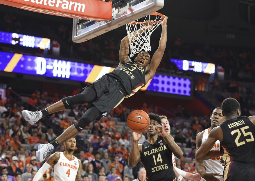 Florida State's Trent Forrest slams in a dunk during the first half of an NCAA college basketball game against Clemson Tuesday, Feb. 19, 2019, in Clemson, S.C. (AP Photo/Richard Shiro)