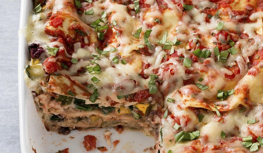"""This undated photo provided by America's Test Kitchen in February 2019 shows Vegetable Lasagna in Brookline, Mass. This recipe appears in the cookbook """"Revolutionary Recipes."""" (Joe Keller/America's Test Kitchen via AP)"""