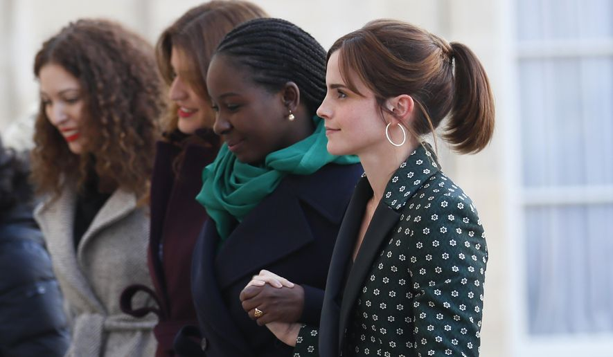 Actress Emma Watson, right, arrives with other women at the Elysee Palace for a meeting on gender equality ahead of the upcoming G7, Tuesday, Feb.19, 2019 at the Elysee Palace in Paris. (AP Photo/Francois Mori)