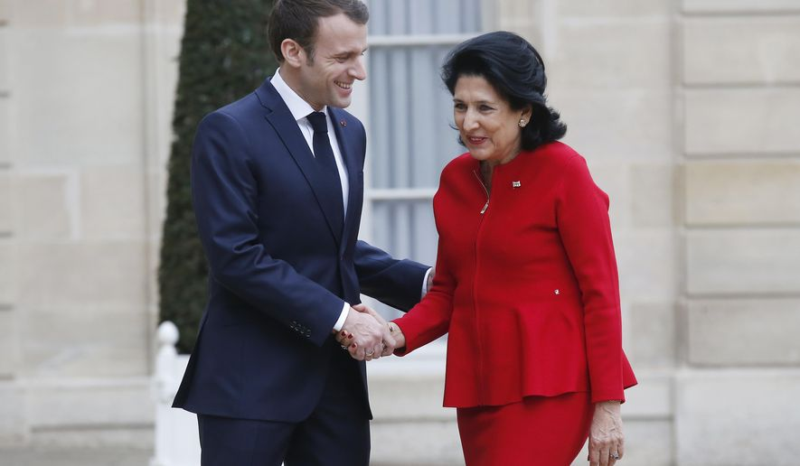 French President Emmanuel Macron, left, welcomes Georgia's President Salome Zourabichvili at the Elysee Palace in Paris, Tuesday, Feb. 19, 2019. Salome Zourabichvili is for three-day visit in France. (AP Photo/Michel Euler)