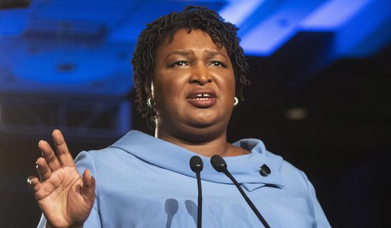 Then-Georgia Democratic gubernatorial candidate Stacey Abrams addresses supporters during an election night watch party in Atlanta, Nov. 6, 2018. (AP Photo/John Amis) ** FILE **