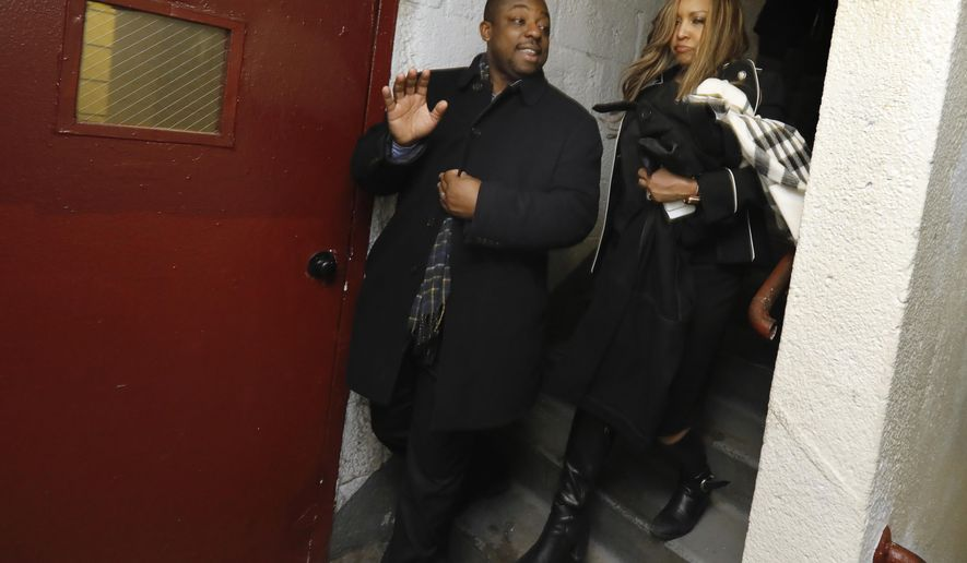 Regional Housing and Urban Development Administrator Lynne Patton, right, accompanied by New York State Sen. Brian Benjamin use stairs after being trapped in a stalled elevator in the Douglas Houses, in New York, Tuesday, Feb. 19, 2019. Patton is spending the next four weeks living in four different New York City Housing Authority buildings to get an up-close look at the city's troubled public housing developments by living there. (AP Photo/Richard Drew)
