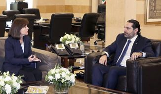 In this photo released by Lebanon's official government photographer Dalati Nohra, United States Ambassador to Lebanon Elizabeth Richard, left, speaks with Lebanese Prime Minister Saad Hariri, at the government House, in Beirut, Lebanon, Tuesday, Feb 19, 2019. Richard has expressed her country's concerns over the growing role of the militant Hezbollah group in the new Cabinet warning that this does not contribute to stability. (Dalati Nohra via AP)