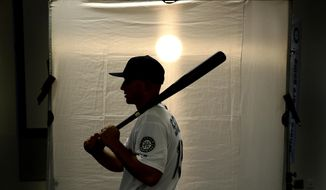 Seattle Mariners' Kyle Seager poses for a photographer during the team's photo day at spring training baseball practice Monday, Feb. 18, 2019, in Peoria, Ariz. (AP Photo/Charlie Riedel)