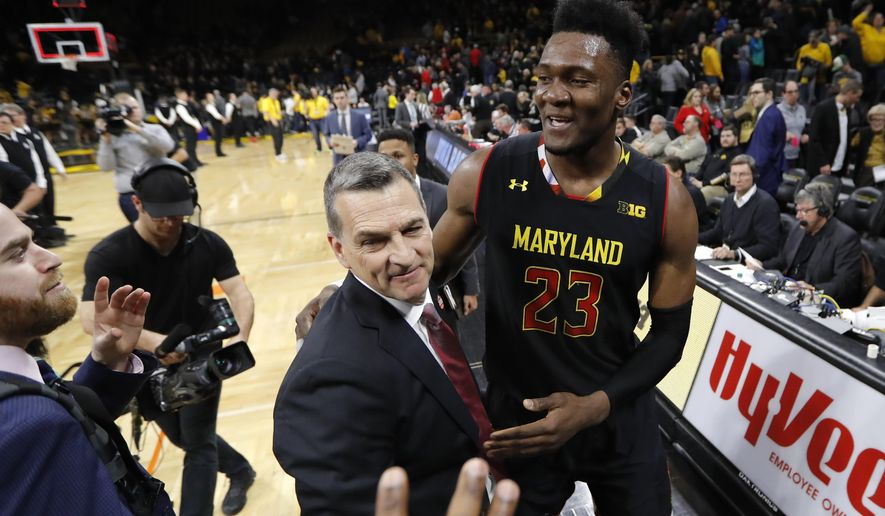 Maryland forward Bruno Fernando (23) celebrates with coach Mark Turgeon after an NCAA college basketball game against Iowa, Tuesday, Feb. 19, 2019, in Iowa City, Iowa. Maryland won 66-65. (AP Photo/Charlie Neibergall)