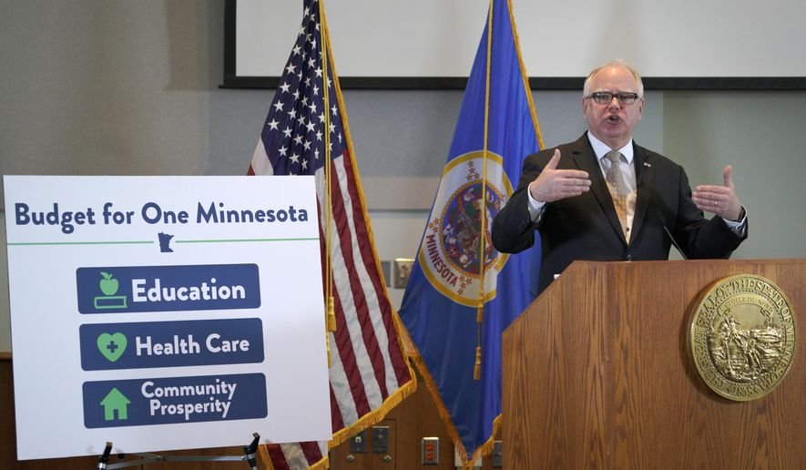 Minnesota Gov. Tim Walz speaks during a press conference Tuesday, Feb. 19, 2019, in St. Paul, Minn. Walz has proposed a $49 billion budget that includes a 20-cent hike in the state's gasoline tax along with significant increases in aid to local school districts. (Brian Peterson/Star Tribune via AP)