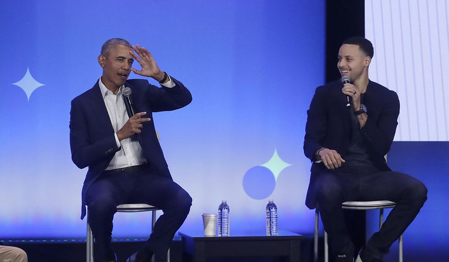 Former President Barack Obama, left, gestures as Golden State Warriors basketball player Stephen Curry laughs while speaking at the My Brother's Keeper Alliance Summit in Oakland, Calif., Tuesday, Feb. 19, 2019. (AP Photo/Jeff Chiu) ** FILE **