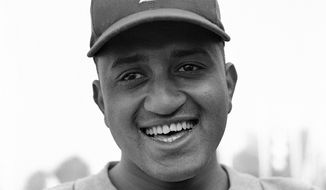 FILE - This is a Feb. 28, 1951, file photo showing Brooklyn Dodgers baseball player Donald Newcombe in Vero Beach, Fla. Newcombe, the hard-throwing Brooklyn Dodgers pitcher who was one of the first black players in the major leagues and who went on to win the rookie of the year, Most Valuable Player and Cy Young awards, has died. He was 92. The team confirmed that Newcombe died Tuesday morning, Feb. 19, 2019, after a lengthy illness. (AP Photo/Harry Harris, File) **FILE**