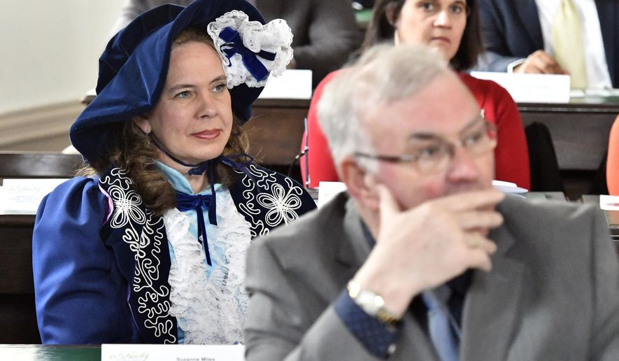 Kentucky state Rep. Suzanne Miles, R-Owensboro is dressed mid-1800's clothing during a session of the legislature held at the Old State Capitol building in Frankfort, Ky., Tuesday, Feb. 19, 2019. The Old State Capitol Building, a National Historic Landmark was the center of Kentucky government from 1830 to 1910.(AP Photo/Timothy D. Easley)