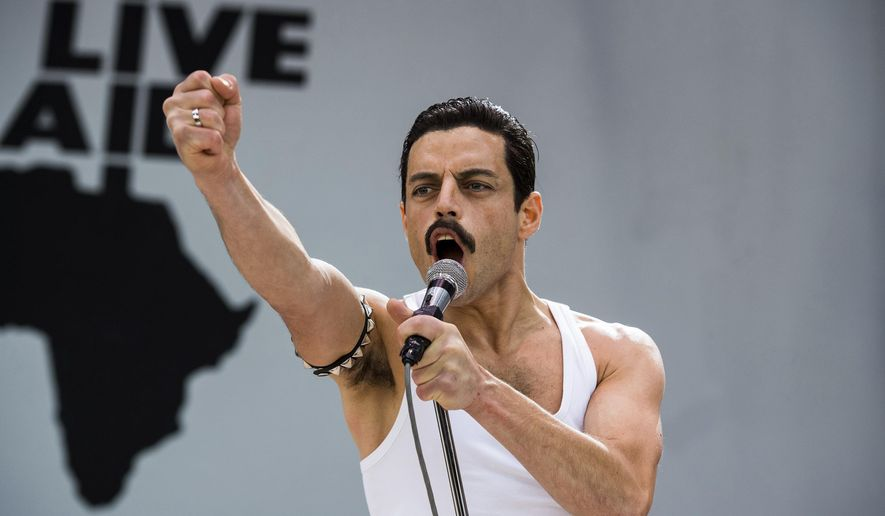 """This image released by Twentieth Century Fox shows Rami Malek in a scene from """"Bohemian Rhapsody."""" Malek is nominated for an Oscar for best actor for his role in the film. The 91st Academy Awards will be held on Sunday. (Alex Bailey/Twentieth Century Fox via AP)"""