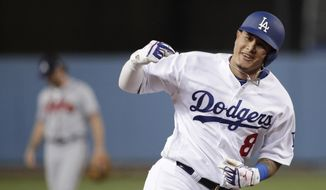 FILE - In this Oct. 5, 2018, file photo, then-Los Angeles Dodgers' Manny Machado celebrates his two-run home run against the Atlanta Braves during the first inning of Game 2 of a baseball National League Division Series, in Los Angeles. A person familiar with the negotiations tells The Associated Press that infielder Manny Machado has agreed to a $300 million, 10-year deal with the rebuilding San Diego Padres, the biggest contract ever for a free agent. The person spoke to the AP on condition of anonymity Tuesday, Feb. 19, 2019,  because the agreement was subject to a successful physical and had not been announced. (AP Photo/Jae C. Hong, File) **FILE**