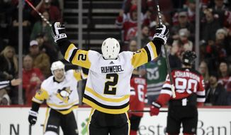 Pittsburgh Penguins defenseman Chad Ruhwedel reacts after scoring a goal on the New Jersey Devils during the second period of an NHL hockey game, Tuesday, Feb. 19, 2019, in Newark, N.J. (AP Photo/Julio Cortez)