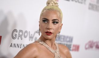 FILE - In this Nov. 29, 2018 file photo, Lady Gaga arrives at the American Cinematheque Award ceremony honoring Bradley Cooper in Beverly Hills, Calif. Lady Gaga and her fiance, talent agent Christian Carino, have split up. A representative for the singer-actress confirmed the news on Tuesday. No more details were provided. Lady Gaga, 32, and Carino, 49, began dating in 2017. She was previously engaged to actor Taylor Kinney. (Photo by Jordan Strauss/Invision/AP, File)
