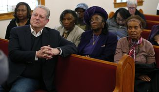 Former Vice President Al Gore, left, listens to speakers during a meeting at the Grove Missionary Baptist Church in Buckingham, Va., Tuesday, Feb. 19, 2019. Gore visited the area that is the proposed site for a compressor station for the Atlantic Coast Pipeline. (AP Photo/Steve Helber)