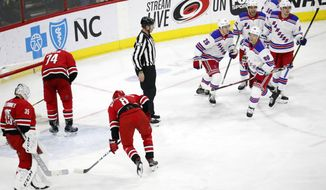 New York Rangers' Vladislav Namestnikov (90) of Russia, celebrates his goal, which proved to be the game winner, with Jimmy Vesey (26), Tony DeAngelo (77) and Pavel Buchnevich (89) of Russia during the third period of an NHL hockey game in Raleigh, N.C., Tuesday, Feb. 19, 2019. Dejected Carolina Hurricanes are Curtis McElhinney (35), Jaccob Slavin (74) and Saku Maenalanen (8) of Finland. (AP Photo/Chris Seward)