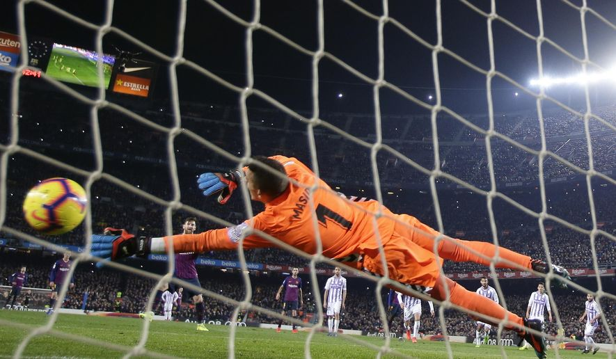 FC Barcelona's Lionel Messi shoots to score his side's opening goal from the penalty spot during the Spanish La Liga soccer match between FC Barcelona and Valladolid at the Camp Nou stadium in Barcelona, Spain, Saturday, Feb. 16, 2019. (AP Photo/Manu Fernandez)
