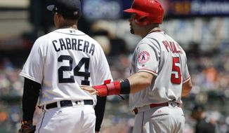 FILE - In this June 8, 2017, file photo, Los Angeles Angels designated hitter Albert Pujols talks with Detroit Tigers first baseman Miguel Cabrera during the fourth inning of a baseball game, in Detroit. Opponents getting friendly during games hasn't always been such a thing. With so many players now switching teams, sharing agents or staying in touch via social media, there are more opportunities to get to know someone you might see only a handful of times.(AP Photo/Carlos Osorio, File)