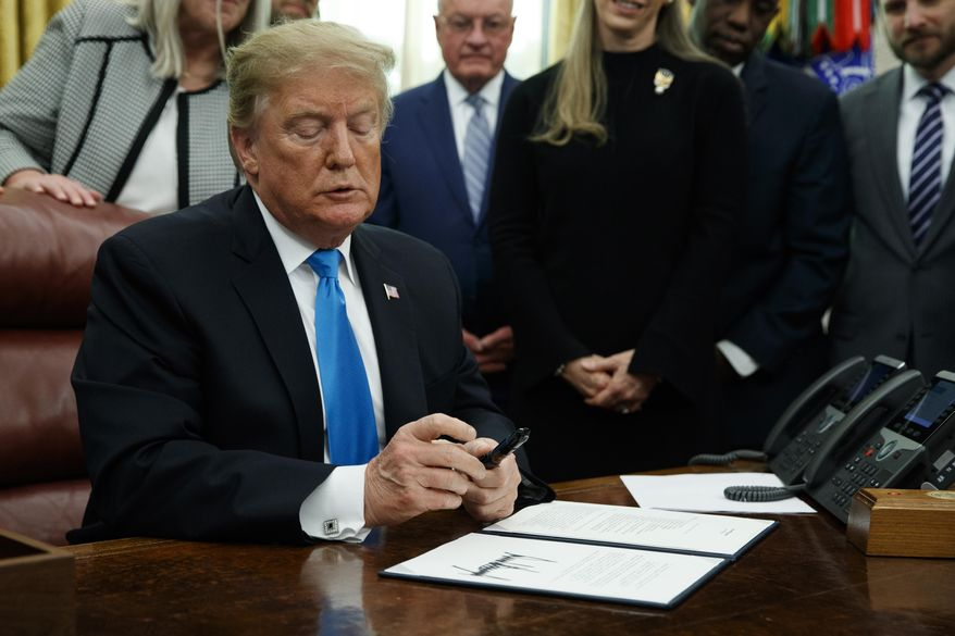 "President Donald Trump pauses during a signing event for ""Space Policy Directive 4"" in the Oval Office of the White House, Tuesday, Feb. 19, 2019, in Washington. (AP Photo/ Evan Vucci)"
