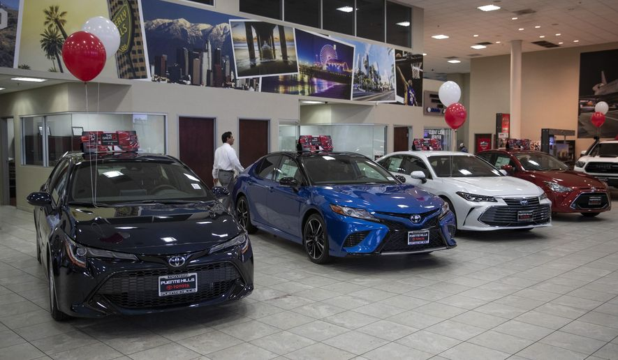 """Toyota sedans are displayed in a showroom at Puente Hills Toyota Thursday, Feb. 14, 2019, in Industry, Calif. If 25 percent tariffs are fully assessed against imported parts and vehicles, and they include Canada and Mexico, the price of imported vehicles would rise more than 17 percent, or around $5,000 each, according to forecasts from IHS Markit. """"I think it would be harmful to the whole economy,"""" said Howard Hakes, president of Hitchcock Automotive, which has three Toyota showrooms in metro Los Angeles. (AP Photo/Jae C. Hong)"""