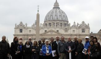 Members of the ECA (Ending of Clergy Abuse) organization and survivors of clergy sex abuse pose for photographers outside St. Peter's Square, at he Vatican, Monday, Feb. 18, 2019. Organizers of Pope Francis' summit on preventing clergy sex abuse will meet this week with a dozen survivor-activists who have come to Rome to protest the Catholic Church's response to date and demand an end to decades of cover-up by church leaders. (AP Photo/Gregorio Borgia)