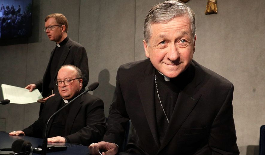 Cardinal Blase J. Cupich, Chicago Archbishop, right, takes his seat with Mons. Charles Scicluna, Malta Archbishop, and the Rev. Hans Zollner, left, ahead of a press conference on a Vatican summit on preventing clergy sex abuse, at the Vatican, Monday, Feb. 18, 2019. Organizers of Pope Francis' summit on preventing clergy sex abuse will meet this week with a dozen survivor-activists who have come to Rome to protest the Catholic Church's response to date and demand an end to decades of cover-up by church leaders. (AP Photo/Gregorio Borgia)