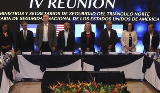 U.S. Secretary of Homeland Security Kirstjen Nielsen, center right, stands with Guatemala's Interior Minister Enrique Degenhart, third from left, El Salvador Minister of Justice and Public Security Mauricio Ramirez Landaverde, center left, and Honduran Security Minister Julian Pacheco, third right, at the start of a meeting on migration and security issues between Nielsen and government ministers from the Northern Triangle countries of Central America, in San Salvador, El Salvador, Wednesday, Feb. 20, 2019. (AP Photo/Salvador Melendez)