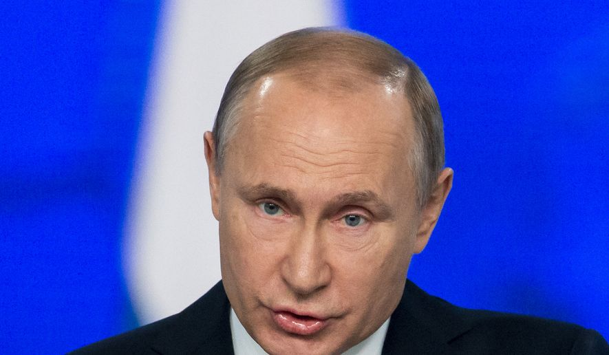 Russian President Vladimir Putin delivers a state-of-the-nation address in Moscow, Russia, Wednesday, Feb. 20, 2019. Putin sternly warned the United States against deploying new missiles in Europe, saying that Russia will retaliate by fielding new weapons that will take just as little time to reach their targets. (AP Photo/Alexander Zemlianichenko)