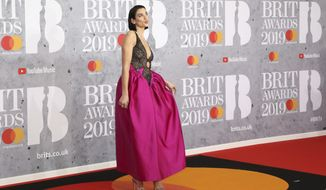 Singer Dua Lipa poses for photographers upon arrival at the Brit Awards in London, Wednesday, Feb. 20, 2019. (Photo by Vianney Le Caer/Invision/AP)